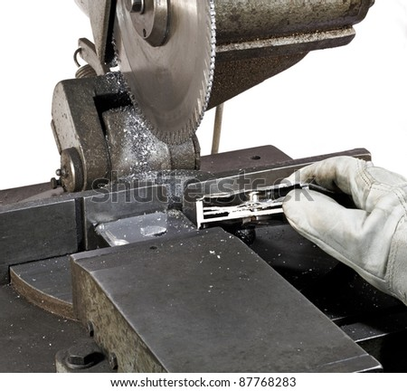 detail of a circular saw and halved hard disk in white back