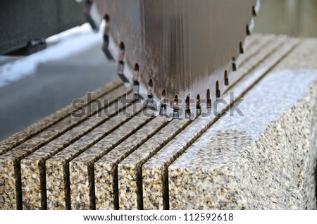 detail of a circular saw used to cut granite - stock photo