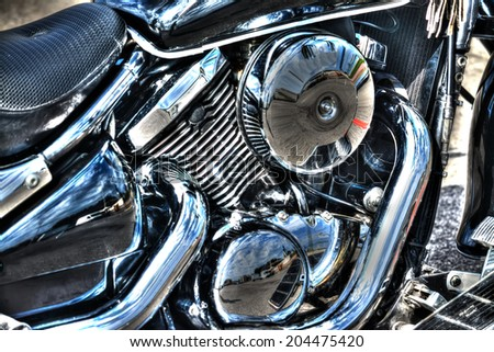 detail of a classic motorcycle engine - stock photo