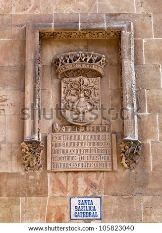 Detail of a coat of arms near the entrance of the New Cathedral (Catedral Nueva) in Salamanca, Spain - stock photo
