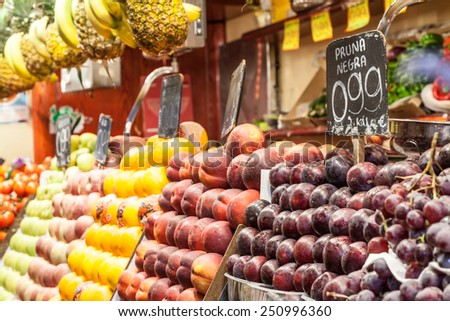 Detail of a colorful fruit market interior, prices in euro - stock photo
