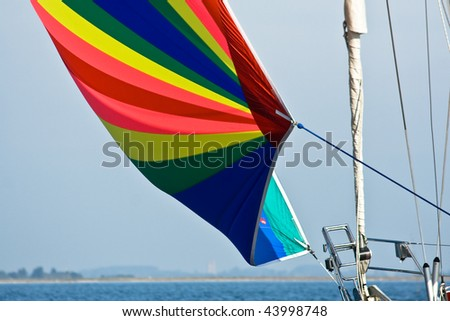 Detail of a colorful spinnaker on a sailing yacht. - stock photo