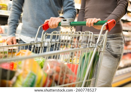 Detail of a couple shopping in a supermarket