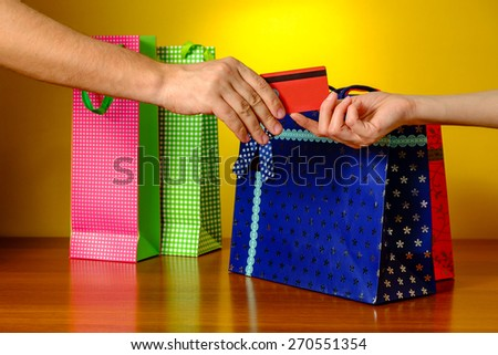 Detail of a credit card payment moment on yellow background - stock photo