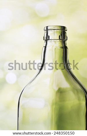 Detail of a crystal bottle against a beautiful background - stock photo