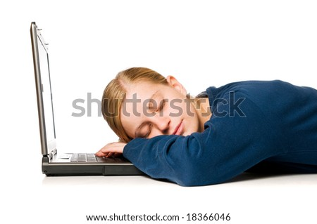 Detail of a cute blonde girl sleeping on her laptop computer, isolated on white background - stock photo