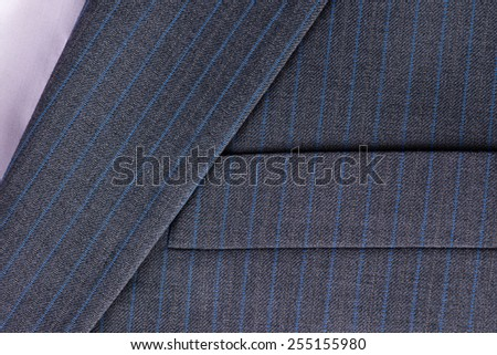 Detail of a dark man suit - stock photo