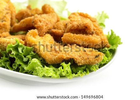 detail of a dish of fried chicken on lettuce - stock photo