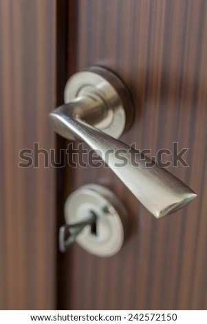 Detail of a door with handle background - stock photo