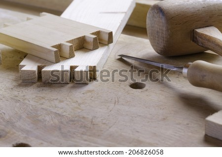 Detail of a dovetail joint before assembling parts - stock photo