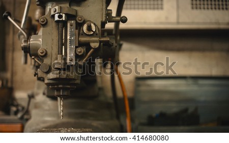 Detail of a drill press in a mechanical workshop. - stock photo