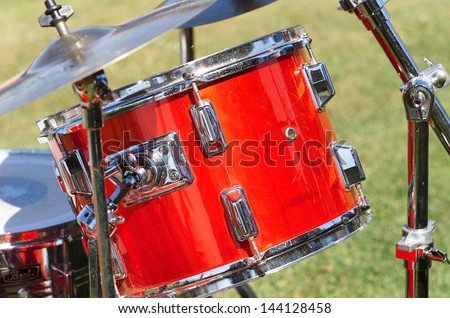 Detail of a drum kit showing Snare Drum and drumsticks
