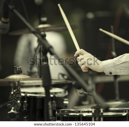 detail of a drummer on the rock concert, selective focus on hands - stock photo