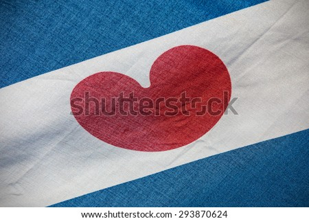 Detail of a Dutch Frisian province flag with the red heart centered - stock photo