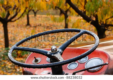 Detail of a farm tractor at a fall colored pear orchard in Oregon - stock photo