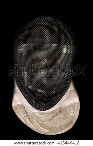 Detail of a fencing protective mask isolated on a black background