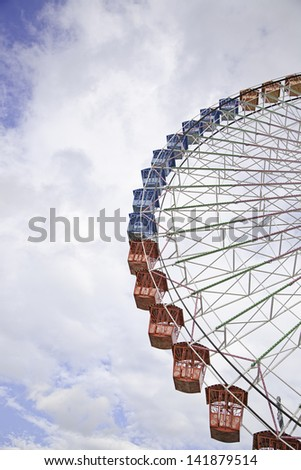 Detail of a ferris wheel, structure of an attraction at a fair in the city - stock photo