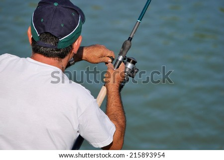 Detail of a Fisherman. Leisure and sport concept - stock photo