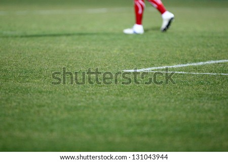 Detail of a football / soccer player game. Selective focus - stock photo