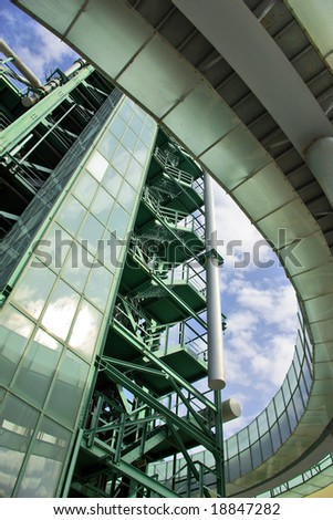 Detail of a fuel transformation facility with metallic tubes and pipelines - stock photo