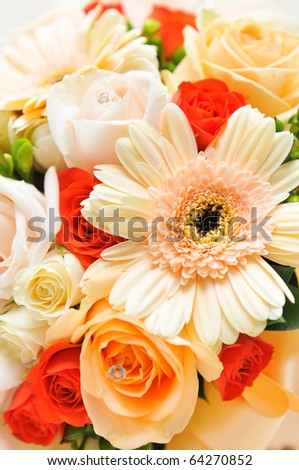 Detail of a gerbera on a bride's bouquet
