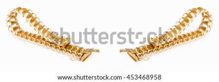 Detail of a gold bracelet on white background