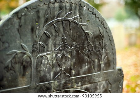 Detail of a gravestone in a cemetery during autumn. - stock photo