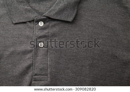 Detail of a gray polo shirt. - stock photo