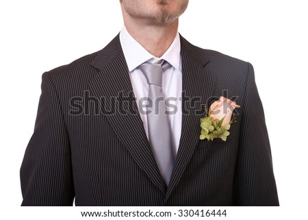 Detail of a groom's necktie and boutonniere