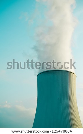 Detail of a huge cooling tower in an industrial area. - stock photo