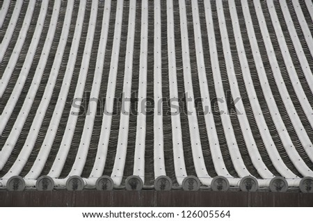 Detail of a japanese roof with traditional roofing tiles - stock photo