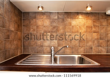 detail of a kitchen sink with tile - stock photo