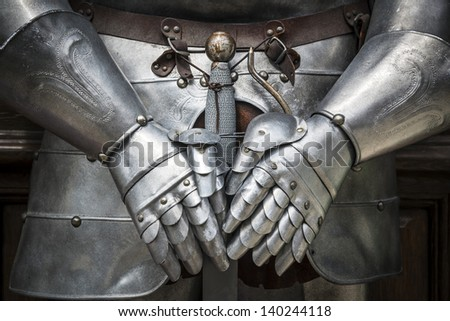 Detail of a knight armor with sword - stock photo