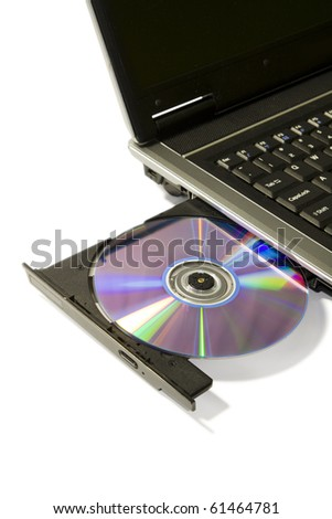 detail of a laptop with open and loaded dvd drive - stock photo