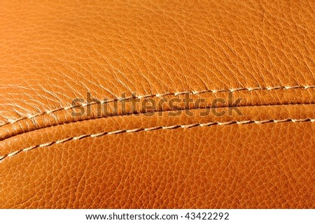 Detail of a leather armchair - stock photo