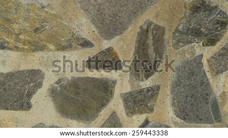 Detail of a light colored flagstone wall. Background photo. Random limestone pattern wall. Grey and yellow house wall. Pavement pattern. Flat stone elements. - stock photo