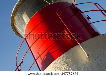 Detail of a lighthouse on the island Yxlan in the Swedish archipelago near Stockholm at sunset - stock photo