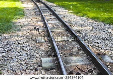Detail of a little tramway in an urban park of Wien - Austria - stock photo