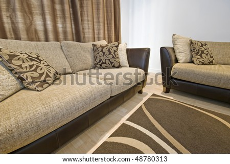 detail of a living room with two modern luxury sofas - stock photo