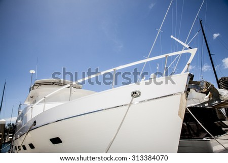 Detail of a luxurious and shiny yacht, parked in a marina - stock photo