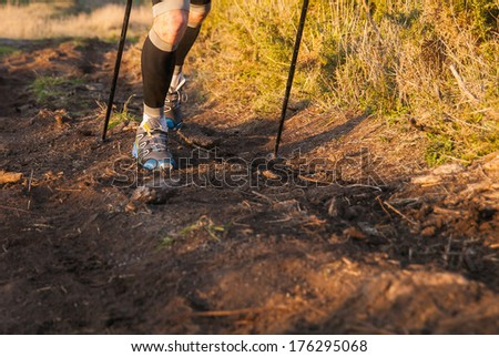 Detail of a man practicing trail running in nature