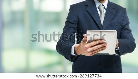 Detail of a man using a tablet computer - stock photo