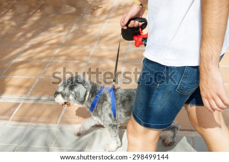 detail of a man walking with the dog - stock photo
