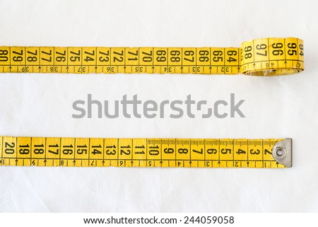 Detail of a measuring tape - stock photo
