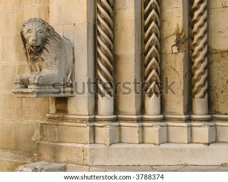 detail of a medieval portal in italy. collegiate church, visso