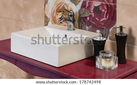 detail of a modern bathroom with floral motif tiles - stock photo