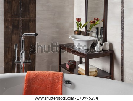 detail of a modern bathroom with tub and sink - stock photo