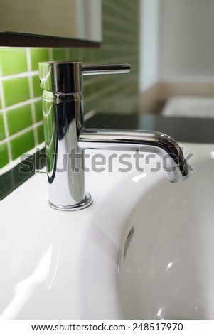 detail of a modern ceramic hand wash basin  - stock photo