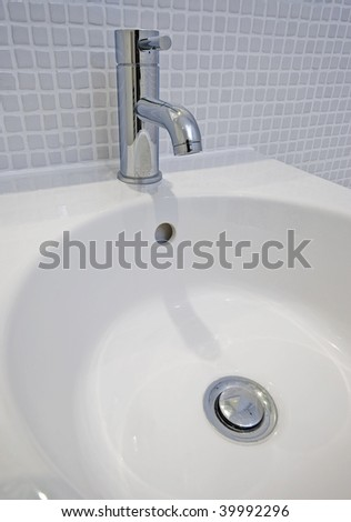 detail of a modern ceramic hand wash basin - stock photo