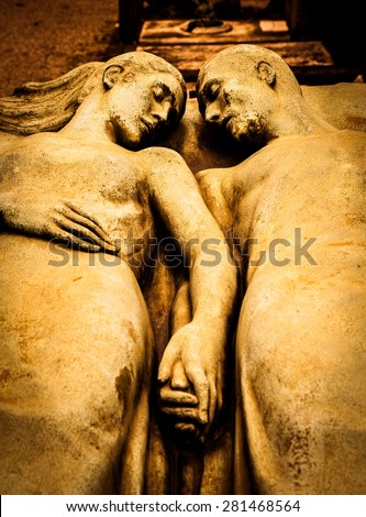 Detail of a more than 100 years old tomb dedicated to a married couple - stock photo